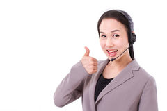 Happy female customer service executive giving thumb up Stock Images
