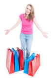 Happy female customer showing what she was buying Stock Image