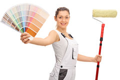 Happy female decorator with color swatch and paint roller. Happy female decorator with a color swatch and a paint roller isolated on white background stock image