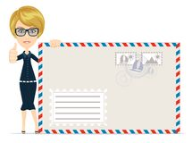 Happy female Delivering Mail Over White Background Royalty Free Stock Photos