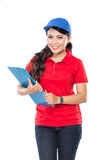 Happy Female delivery service with clipboard. A portrait of Happy Female delivery service with clipboard Stock Photo