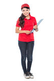 Happy Female delivery service with clipboard Stock Photo