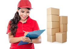Happy Female delivery service with clipboard Royalty Free Stock Photo
