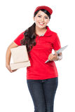 Happy Female delivery service with clipboard. A portrait of Happy Female delivery service with clipboard and package Royalty Free Stock Photo