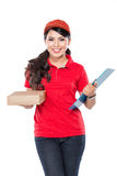 Happy Female delivery service with clipboard. A portrait of Happy Female delivery service with clipboard and package Stock Photos