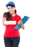 Happy Female delivery service with clipboard. A portrait of Happy Female delivery service with clipboard and package. stretched her arm out Stock Images