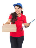 Happy Female delivery service with clipboard. A portrait of Happy Female delivery service with clipboard and package. stretched her arm out Stock Photo