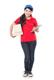 Happy Female delivery service with clipboard. A portrait of Happy Female delivery service with clipboard and package. stretched her arm out Stock Photos