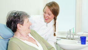 Happy female dentist with patient looking at camera stock video