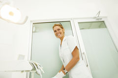 Happy female dentist. Working and smiling Stock Photography