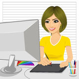 Happy female designer in office working with digital graphic tablet and digital pen Stock Photos