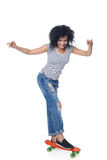 Happy female in distressed jeans with skateboard Royalty Free Stock Photography