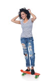 Happy female in distressed jeans with skateboard Stock Photos