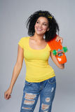 Happy female in distressed jeans with skateboard Stock Photo