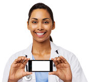 Happy Female Doctor Advertising Smart Phone Stock Images