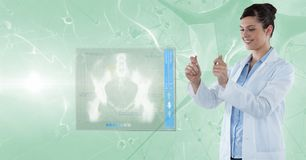 Happy female doctor analyzing reports on transparent digital tablet Royalty Free Stock Images
