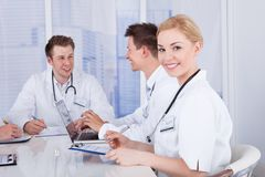Happy Female Doctor In Conference Meeting Stock Photo