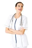 Happy female doctor with folded arms Royalty Free Stock Image