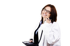 Happy female doctor hanging on the phone Royalty Free Stock Images