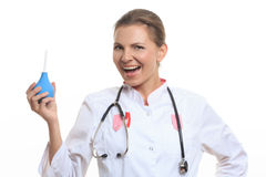Happy female doctor holding enema Stock Images