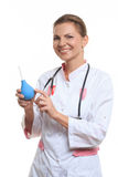 Happy female doctor holding enema Stock Photo