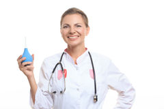 Happy female doctor holding enema Stock Photos