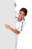 Happy female doctor holding placard Stock Photography