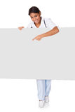 Happy Female Doctor Holding Placard Royalty Free Stock Images