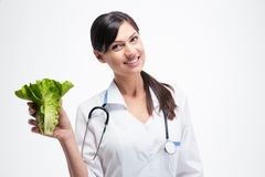 Happy female doctor holding salad Royalty Free Stock Photo