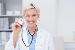 Happy female doctor holding stethoscope Royalty Free Stock Photo