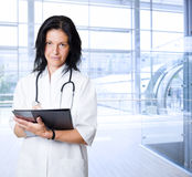Happy female doctor at hospital Royalty Free Stock Photos