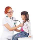 A happy female doctor inspecting a little brunette girl Royalty Free Stock Photography