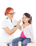 A happy female doctor inspecting a little brunette girl Stock Images