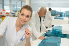 Happy female doctor with lab coat stock images