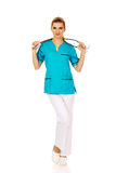 Happy female doctor or nurse with stethoscope Royalty Free Stock Image