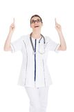 Happy female doctor pointing up Stock Photography