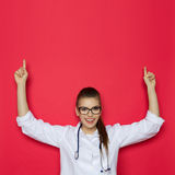 Happy Female Doctor Pointing Up Royalty Free Stock Image