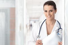 Happy female doctor Stock Photos