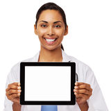Happy Female Doctor Promoting Digital Tablet Stock Photo