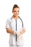Happy female doctor putting on protective gloves Stock Images