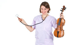 Happy female doctor with stethoscope and violin Royalty Free Stock Photos