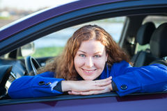 Happy woman driver in car Stock Photos