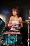 Happy female drummer Royalty Free Stock Photo