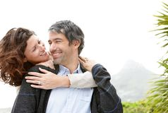 Happy female embracing her husband from behind Royalty Free Stock Photos