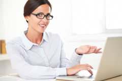 Happy female employee using the computer Stock Photography