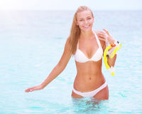 Happy female enjoying beach activities Royalty Free Stock Images