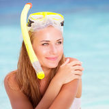 Happy female enjoying beach activities Stock Image