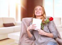 Happy female enjoying greeting card Royalty Free Stock Images