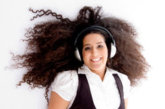 Happy female enjoying music track. On an isolated white background Stock Photography