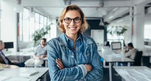 Happy female executive with arms crossed Royalty Free Stock Photo
